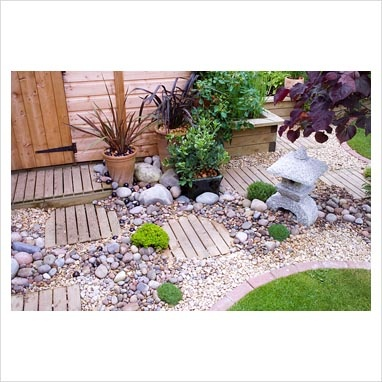 mix rock and gravel for something less constructed or sterile - Garden Design Gravel Patio