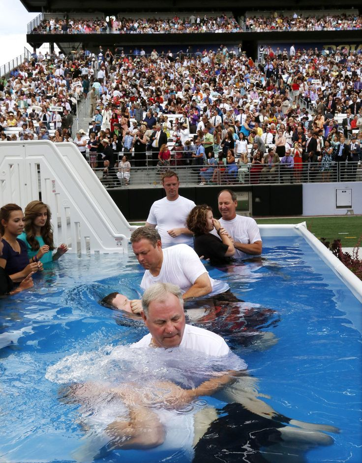 At Jehovah's Witnesses event, baptisms in the end zone | Picture This | The Seattle Times