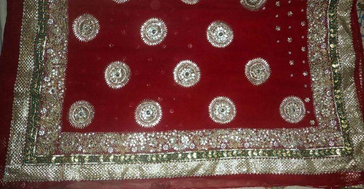 Radiant red ravishing Saree with beautiful design work.