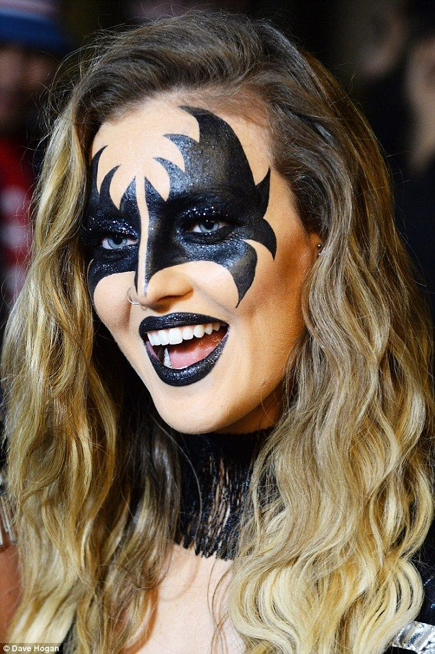 Gene, is that you? Perrie Edwards looked amazing in batwing makeup and a matching black gl...