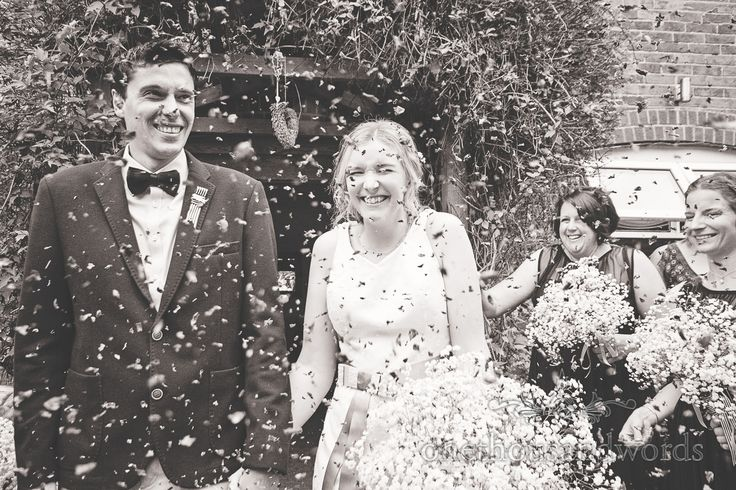 Wedding confetti photograph at Balmer Lawn Hotel Wedding. Photography by one thousand words wedding photographers
