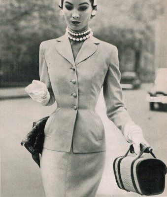 Shapely suit and pearls 1950s, love the look.