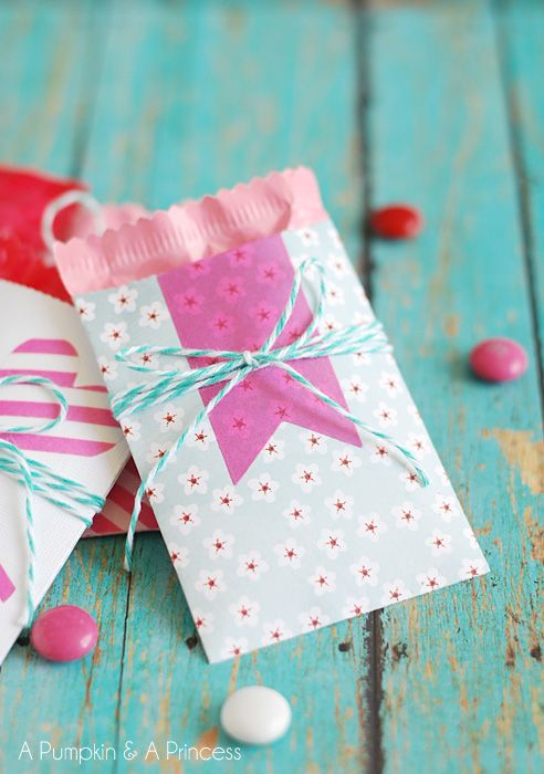 Mini paper pockets to hold Valentine cards and treats.