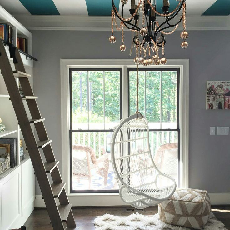 Hanging Chair, Anthropologie Rug, Rolling Library Ladder And Striped  Ceiling Create A Unique And Stunning Home Office.