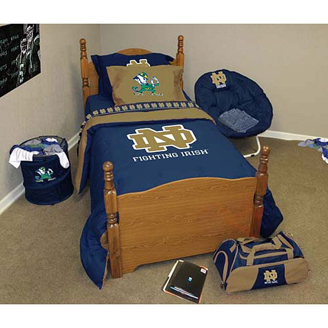 Show your team spirit with a Notre Dame bedding setSet includes fitted sheet, flat sheet, two pillowcases, two pillow shams, comforter and bed skirtReversible comforter features Notre Dame colors and logo