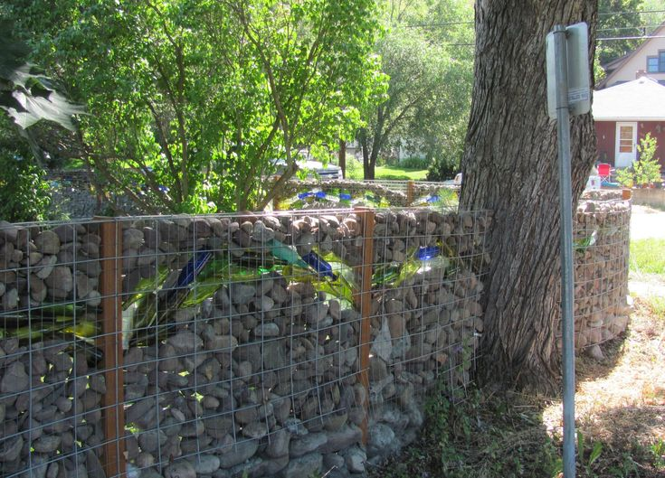 Creative Fence Design E2 80 93 Diy Ideas For Your Own Front Yard Part 3 Empty Glass Bottles And Pebbles Make Interesting. small kitchen design ideas. curtain design ideas. bedroom design ideas. bar design ideas.