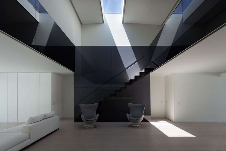 http://boomzer.com/golf-course-sight-or-a-obvious-exterior-make-for-a-contemporary-marvel/captains-chairs-grey-sofa-egg-black-glass-wall-ceiling-glass-tile-wooden-floor-white-velvet-sofa-white-wardrobe-natural-sunlight-fran-silvestre-arquitectos/