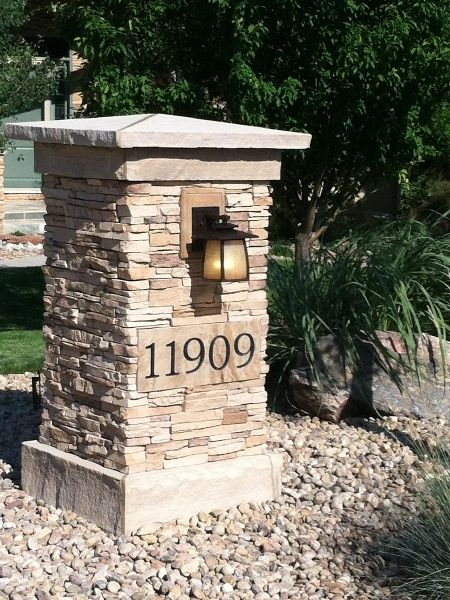 stone pillar with house numbers on it home entry pillar