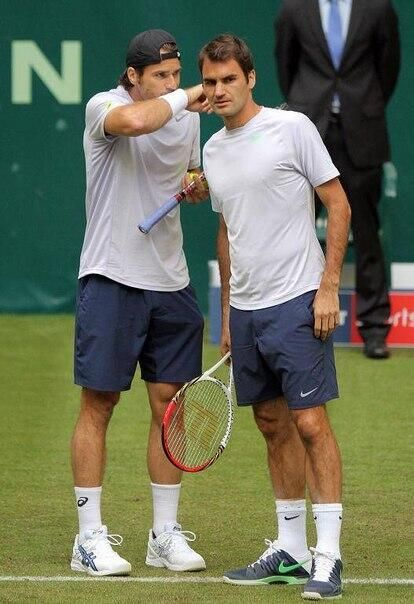 Tommy Haas & Roger Federer playing doubles at the 2013 Gerry Weber Open in Halle, Germany