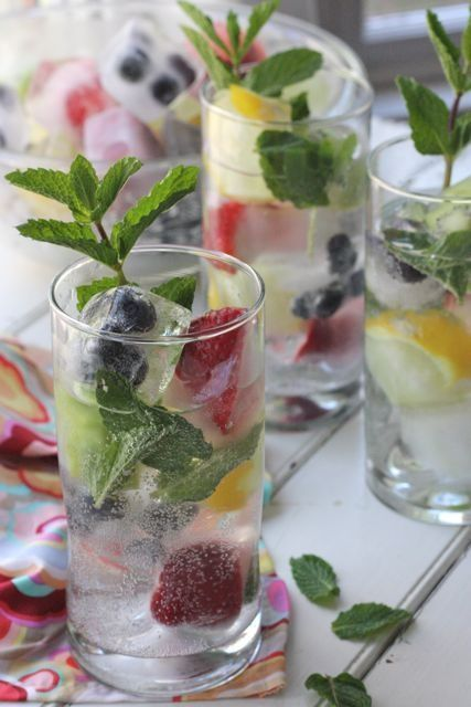 Recipe for Low Calorie Spritzers with Fruit Ice Cubes - I love these fruit ice cubes for so many different beverages. They are perfect in a fruit punch, sparkly in a glass of lemonade and especially lovely in iced tea.