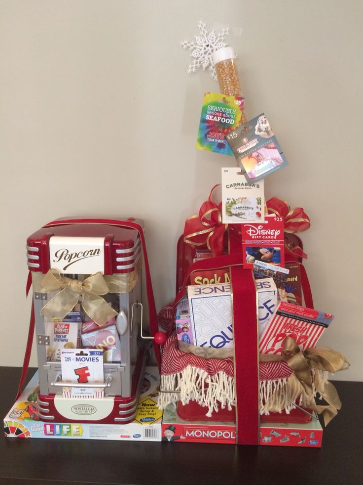 Family Fun Night basket with retro popcorn maker, retro picnic basket, games, gift cards and candies