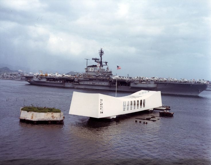 USS Coral Sea (CVA-43)- Passes the USS Arizona Memorial, Pearl Harbor, Hawaii, 18 April 1963. Photographed by PHCS Robert A. Carlisle, USN. Official U.S. Navy Photograph, from the collections of the Naval History and Heritage Command.