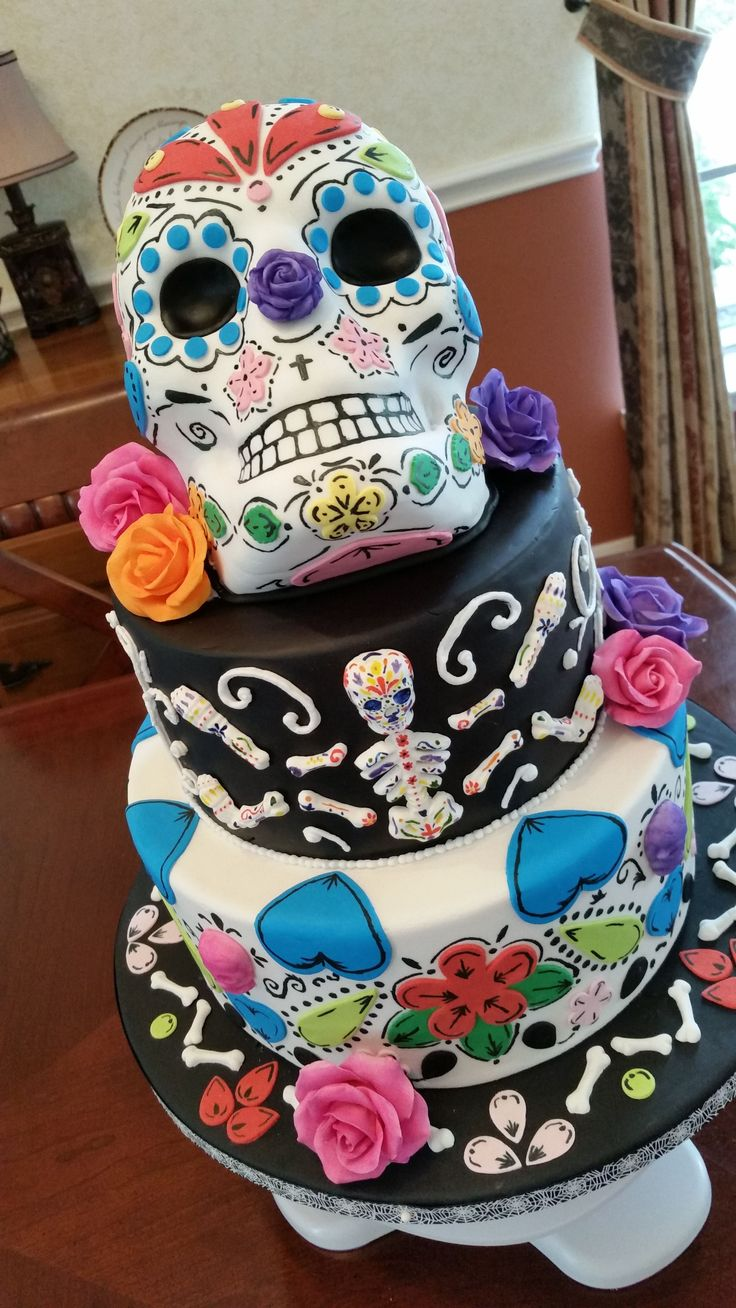 - Day of the dead cake with fondant and gumpaste decorations.