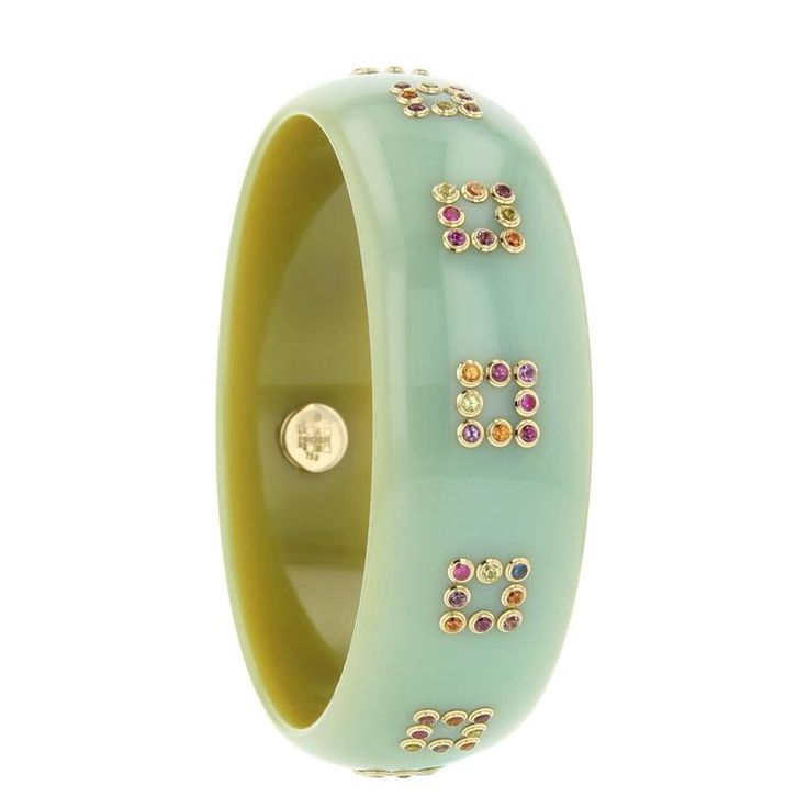 Mark Davis Bakelite Amethyst Peridot Garnet Sapphire Bangle    From a unique collection of vintage bangles at https://www.1stdibs.com/jewelry/bracelets/bangles/