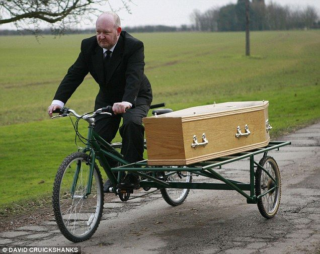 Reverend Paul Sinclair of Motorcycle Funerals created the unique mode of funereal transport but found he was not fit enough to operate it for sale only tandem bike hearse ...how freaky is that !