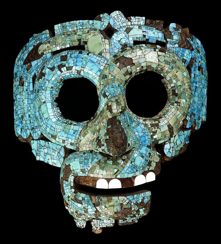 This mask represents the Aztec god of rain, Tlaloc, who is characterised by large eyes and a twisted nose. The mask is formed from two snakes which intertwine to create the face, their tails forming the eyebrows (originally gold). This object has also been associated with Quetzalcoatl, the feather serpent, because of the feathers which hang down from the eyebrows. Made in Mexico about 500 years ago, the mask may have been worn by a priest during rituals.  #Aztec #Mixtec #turquoise #mask…