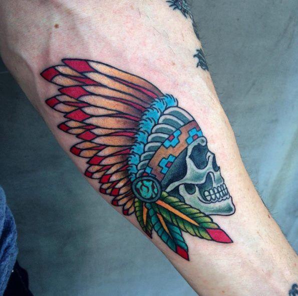 Traditional skull headdress tattoo by Andrea Revenant