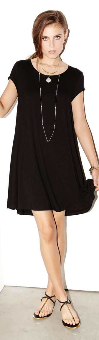The Maggie Dress is crafted from comfortable jersey in a trapeze silhouette that falls into a flattering hi-lo hem. #lbd