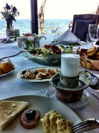 Proper way to get intoxicated like a Turk: Drink raki and eat mezes by the Mediterranean.