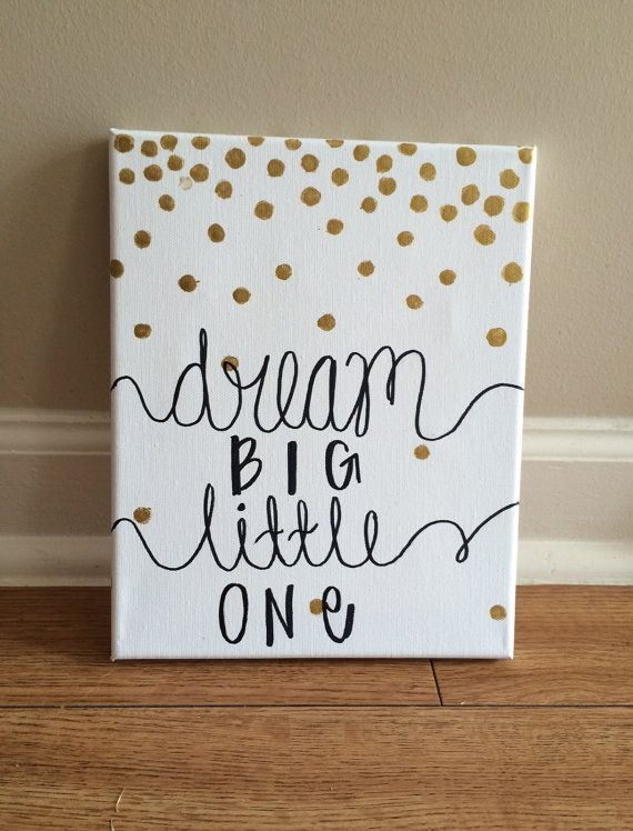 How sweet would this 8x10 canvas look in your little ones nursery? Canvas reads Dream big little one in black with gold, cascading polka dots.