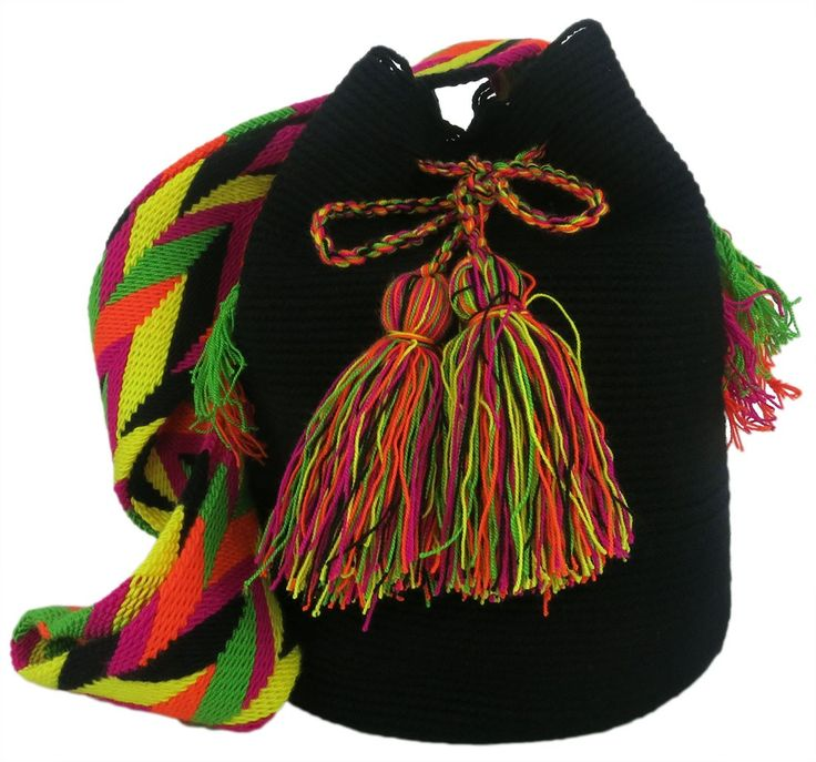 One of a kind authentic two threads Wayuu Mochila bag with a cinch strap. Two classic tassels close the bag.