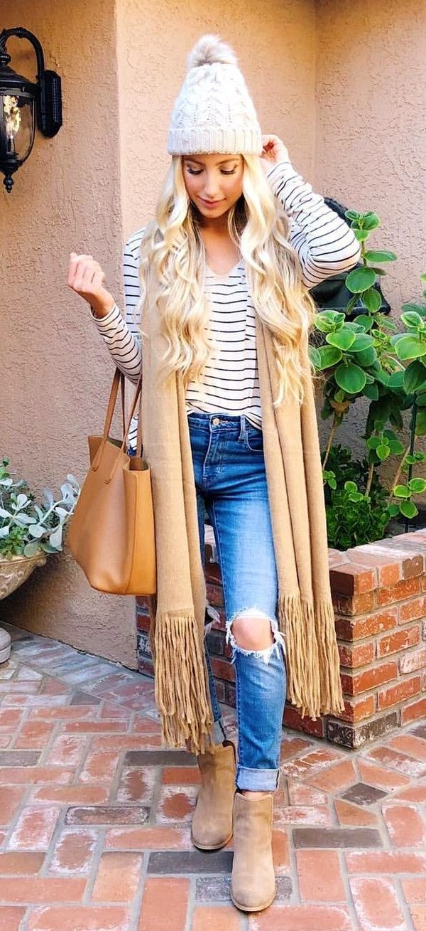 #winter #outfits  women's stripe long-sleeved shirt, distressed blue-washed jeans, and pair of brown boots outfit
