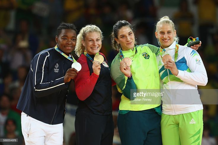 Silver medalist Audrey Tcheumeo of France, gold medalist Kayla Harrison of the United States and bronze medalists Mayra Aguiar of Brazil and Anamari Velensek of Slovenia celebrate on the podium after the women's -78kg judo contest on Day 6 of the 2016 Rio Olympics at Carioca Arena 2 on August 11, 2016 in Rio de Janeiro, Brazil.