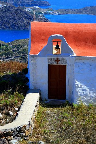 Red-roofed church overlooking Skala Bay. Patmos island, Dodecanese, Greece