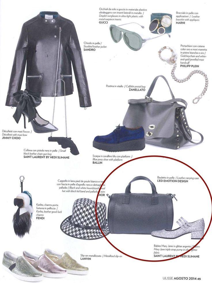 "#Ledemotiondesign TAI ""flies"" on Alitalia magazine! http://bit.ly/TAI_LED #handbags #bags #trip"