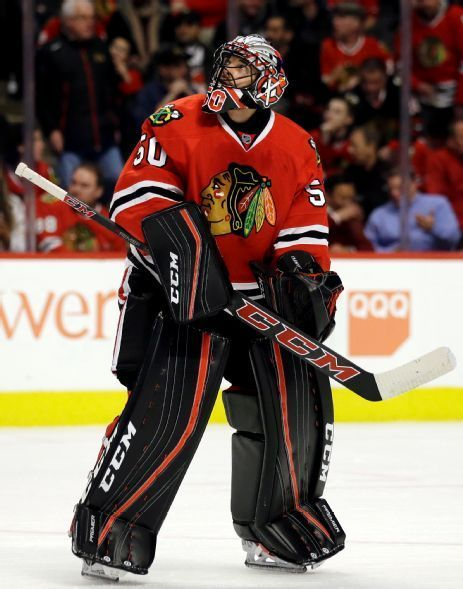Chicago Blackhawks goalie Corey Crawford looks up a score board during the first period of an NHL hockey game against the Dallas Stars Thursday, Feb. 11, 2016, in Chicago. (AP Photo/Nam Y. Huh)