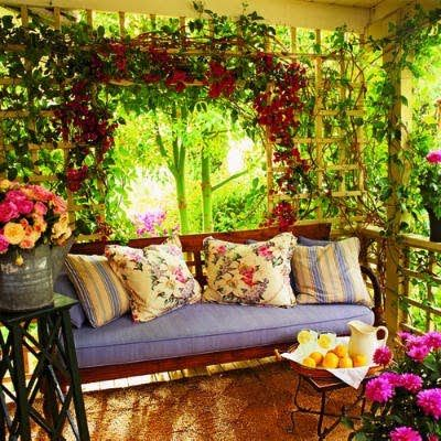 Beautiful outside seating area. Great mix of colours, blooms and fabrics.