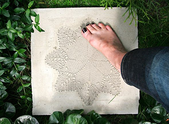 DIY lace decorated concrete plate for the garden