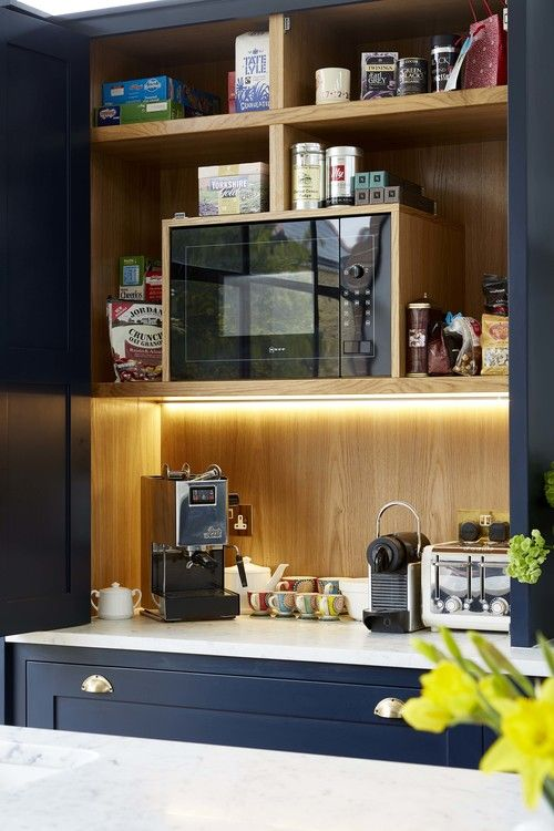 Oh I do love an English kitchen. The wooden cabinets, in this case with a bold navy finish, the...