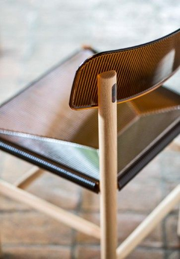 Chair.  Material: frame in natural solid beech. Seat and back in polycarbonate.