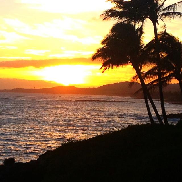 Watch the sunset from Kauai.