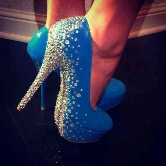 Blue pumps with a underside covered in white rhinestones and up the back of the shoe.