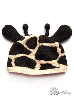 """The """"Giraffe"""" hat is worked flat and seamed in the back, with knitted ears and crocheted horns worked separately and sewn to the body of the hat. Adjoining color sections will match up into one continuous spot after the hat has been seamed. The colorwork pattern is charted, instructions for cuff, ears and horns are written out."""