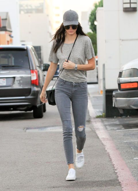 Prior to celebrating the 30th birthday of Balmain's Olivier Rousteing, Jenner stepped out in Los Angeles to teach a lesson in the art of casual-chic. The formula? All gray everything, complimented by shades, a shoulder bag and white sneakers. This might be a look even we could pull off.
