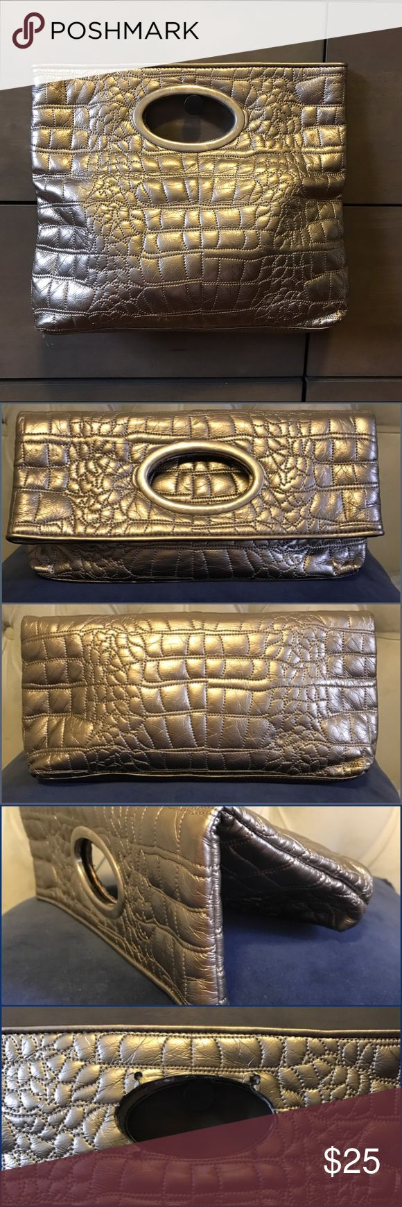 CARLOS  Folding Clutch Pale Gold, Snake Texture Cute clutch, pale gold color - not over the top. One metal handle is missing as shown in pics - not so noticeable especially when folded. Carlos Santana Bags Clutches & Wristlets
