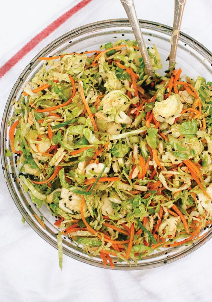 This Asian Brussels Sprout Slaw with Carrots and Almonds makes the perfect dish to take to a summer cookout!