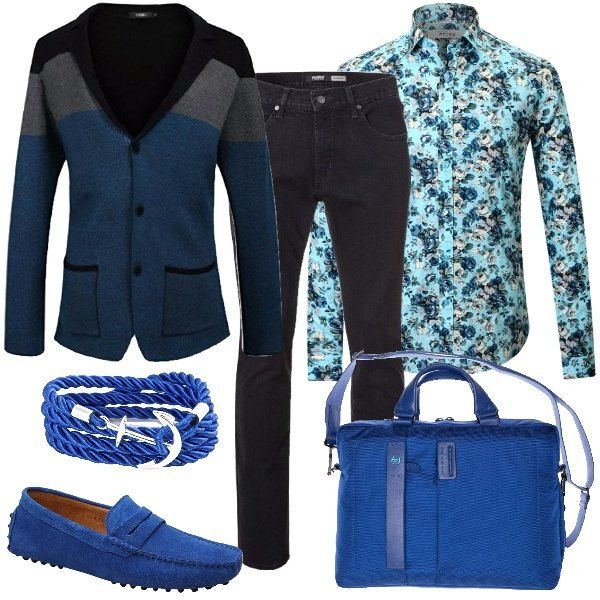 Outfit che vede in primo piano il colore blu per l'uomo che in ufficio non rinuncia ai colori e vuole colpire. Il total look è composto da un blazer in tre colori, nero, grigio e blu, un jeans in nero, una camicia floreale in cotone, un paio di mocassini scamosciati in blu elettrico, una borsa porta pc in blu elettrico e per finire da un bracciale in corda blu e ancora in argento.