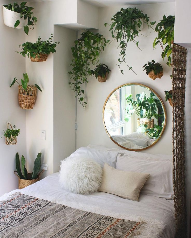 Hang a strategically-placed mirror to make the room feel larger than it really i…