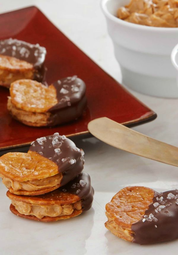 Sweet and salty flavors combine in these chocolate-coated, Town House Sea Salt Pretzel Thins sandwiched around a peanut butter filling! This crunchy dessert recipe will keep your party guests coming back for more.