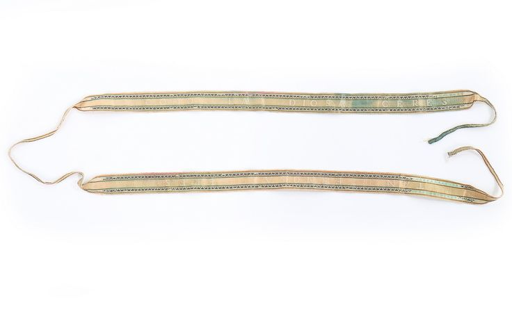 """Pair of ladies garters, ca. 1775-1790. Pink silk satin with silver thread borders woven """"Tan Ermosa Eres"""" and """"Como La Diosa Ceres"""" (You are as beatiful as the Goddess Ceres)."""