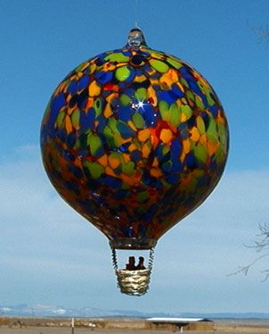 Stained glass light bulb or hot air balloon - very similar concept to the glass ball we blew!