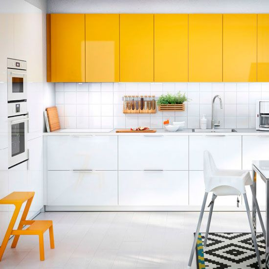 A white kitchen can feel fresh and bright but has the tendancy to look a little sterile, take the edge off with simple, colour updates