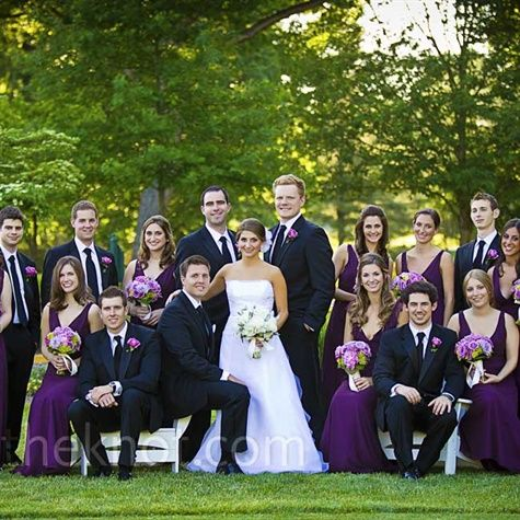 Eggplant-colored chiffon dresses with tiered layers in the back gave bridesmaids an elegant, ethereal look