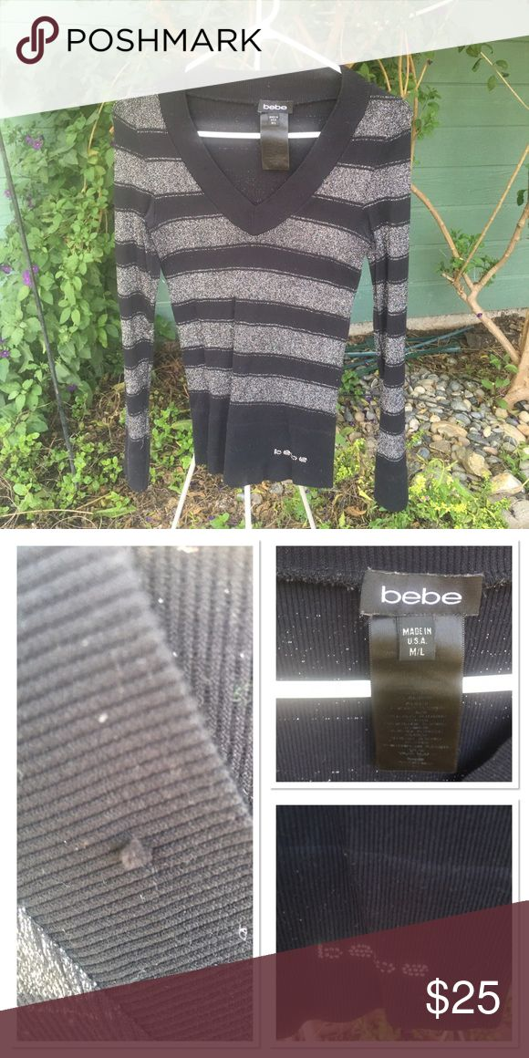 🆕LISTING- Bebe Blk & Silver Long Sleeve Top Preloved with minor snags in fabric. This used to be my favorite top but now it's too small after my last baby 😥 Still super cute and wearable. Very stretchy material. Can fit SZ 6-10 (as I varied in that range when I wore it) bebe Tops