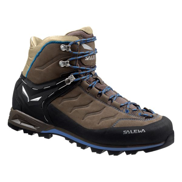 Designed for intense forays into rugged high-mountain terrain, the Salewa Men's Mountain Trainer Mid Backpacking Boots provide the support, comfort, and aggressiveness you need when hiking above treeline. Their durable and wear-resistant suede upper is reinforced with a 360-degree rubber rand to protect against wear when hiking across rock-strewn trails, and they sport elements of approach shoes to ensure they're up to the task of near-vertical climbs and scrambles up scree fields. T...