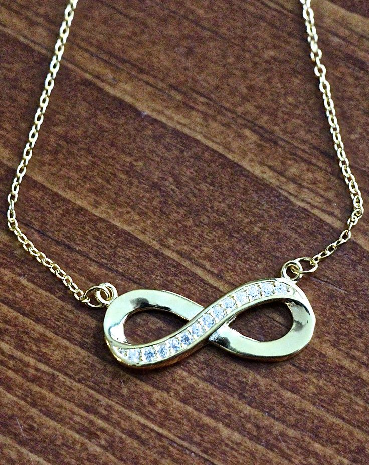 """This Sterling silver, gold plated infinity pendant necklace is a lovely jewelry gift to symbolize unity and love everlasting. Order a couples jewelry gift today for your fiancé, wife, or girlfriend to celebrate an anniversary, birthday, wedding, Valentine's Day or to simply say """"I love you forever!""""  The infinity pendant measures 11mm and is accented with cubic zirconia to add the perfect amount of sparkle  for everyday wear and includes two 1″ extenders to allow for three lengths: 16″, 17″…"""